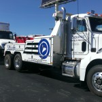 squires services tow truck towing a box truck