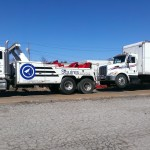 squires services towing a large commercial delivery truck