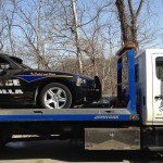Squires Services towing police car