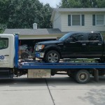 squires services towing black truck